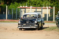 Old american car on beach in Trinidad Cuba Stock Photos
