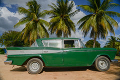 Old american car on beach in Trinidad Cuba Royalty Free Stock Images