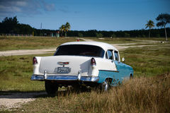 Old american car on beach in Trinidad Cuba Royalty Free Stock Photography