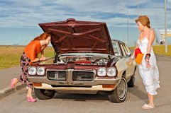 Old American car brokedown Royalty Free Stock Images