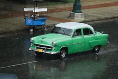 Old American Car in Cuba. Old style american car in Cuba at the rainy weather stock photography