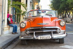 Old american car in Cuba. Vintage red Chevrolet parked near El Prado street  in Havana.These old classic cars have become an iconic sight and a tourist Royalty Free Stock Photo