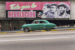 Old american car and cuban revolution Stock Images