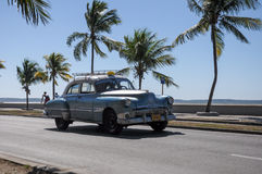 Old american car drive on Malecon, Cuba Stock Image