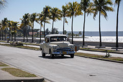 Old american car drive on Malecon, Cuba Royalty Free Stock Image