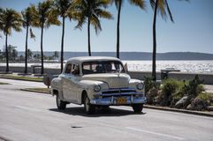 Old american car drive on Malecon, Cuba Royalty Free Stock Photography