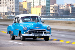 Old american car at the famous Malecon avenue in Havana. HAVANA,CUBA - OCTOBER 25,2016 : Old american car at the famous seaside Malecon avenue in Havana Stock Images