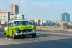 Old american car at the Malecon avenue in Havana. HAVANA,CUBA - FEBRUARY 4, 2016 : Old american car at the Malecon avenue in Havana Royalty Free Stock Photography