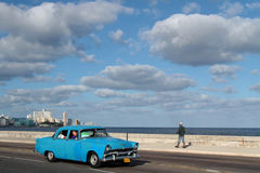 Old American car on Malecon Stock Photography