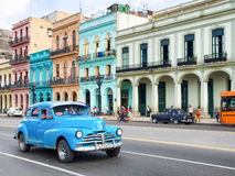 Old american car near colorful buildings in Havana Royalty Free Stock Images