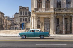 Old american car in Old Havana, Cuba. A green classic american car running in Malecon, Havana stock images