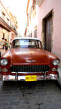 Old American car. Red Chevrolet. 1950 car, parked in the street of Havana Stock Images
