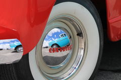 Old American car. Reflected on Chevrolet hubcap. outdoors, natural light. Miami, Florida Stock Photography