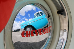 Old American car. Reflected on Chevrolet hubcap. outdoors, natural light. Miami, Florida Stock Image