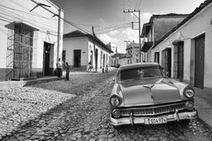 Old american car on the road in Trinidad, Cuba. Royalty Free Stock Photography