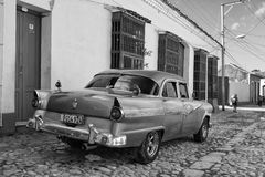 Old american car on the road in Trinidad, Cuba. Royalty Free Stock Images