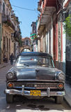 Old american car in a shabby street in Havana Royalty Free Stock Photos