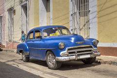 Old american car in Trinidad, Cuba. Blue old american car parked in the streets of Trinidad, Cuba Royalty Free Stock Photography