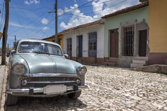 Old american car in Trinidad, Cuba. Front view of a classic american car, in a typical street of Trinidad, Cuba royalty free stock photo