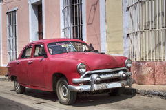 Old american car in Trinidad, Cuba. Red classic american car parked in Trinidad, Cuba Stock Photos