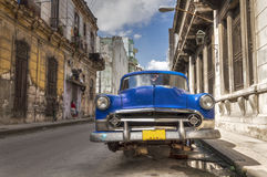 Old american car without wheels in Havana. Classic american car without wheels parked in Old Havana, Cuba royalty free stock photography