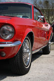 Old american classic car. Old red Ford Mustang on an american car meeting Stock Photo