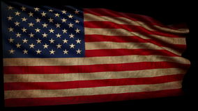 Old American flag is developing slowly in the wind. + alfa. Loop animation stock footage
