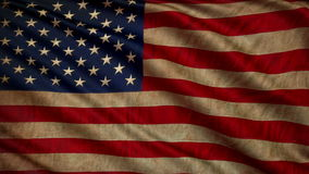 Old American flag is developing slowly in the wind. Loop animation stock video footage