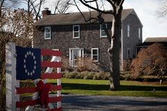 Old house. Old american flag in front of vintage house Stock Photography