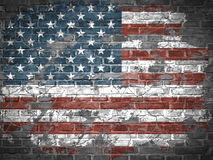 Old American flag. On the grunge brick Royalty Free Stock Image