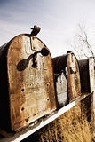 Old American mailboxes in midwest. Old American mailboxes in late sun, rusting away in rural Midwest royalty free stock image