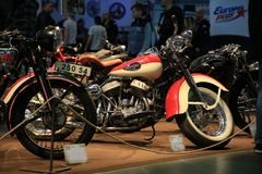 Old American motorcycle Harley Davidson WLD red and beige 1940, right side. Close up. Time of the International motorcycle industry salon IMIS2018. Lenexpo stock photography
