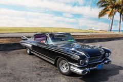 Old american retro-mobile, black vintage car, enormous big. stock image