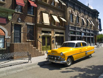 Old American Taxi in a old town Stock Photo