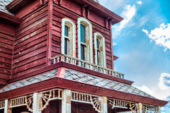 Old american western red house against blue sky Stock Photography