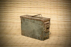 Old ammunition box still life mat weave background. Picture stock photography