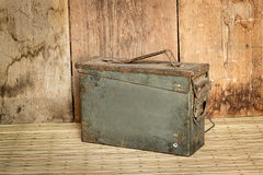 Old ammunition box still life mat weave and wood board backgroun. D stock images