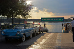 Old amphibian cars with flags in the parking Stock Images