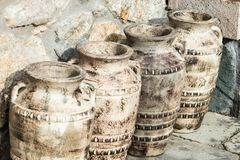 Old amphora. Four old water amphora handcrafted Stock Photo