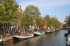 Old Amsterdam. Canal with historic sailing boats in Old Amsterdam Royalty Free Stock Image