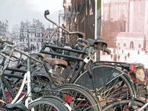 Old Amsterdam. Current day bicycles parked up against large street posters of scenes of old Amsterdam Royalty Free Stock Image