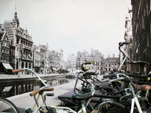 Old Amsterdam. Modern day bicycles parked against a roadside poster of old Amsterdam Stock Image