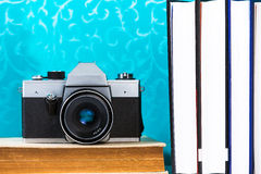 Old analog camera on book Stock Photo
