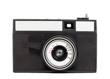 Old analog camera on film 35mm format isolated on a white background. Original old analog camera with lens on film 35mm format stock image