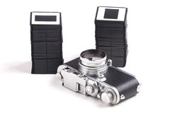 Old analog Camera and Stack of slides Royalty Free Stock Photo