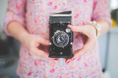 Old analog camera in woman's hands Royalty Free Stock Photos
