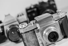 Old analog cameras. Three old analog cameras manufactured by from firs plan: Praktiflex now Praktica, Pentax and Zenit Royalty Free Stock Photography