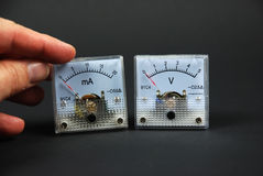 Old and analog current and voltage meters Royalty Free Stock Photography