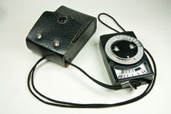 Old analog exposure meter with leather case Stock Photos