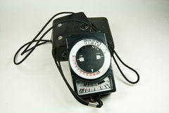 Old analog exposure meter with leather case Stock Images